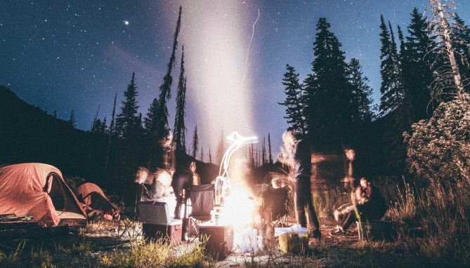 Creepy campfire outside under the stars.