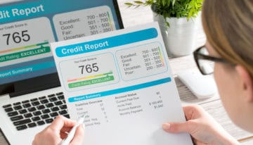 Woman holding credit report