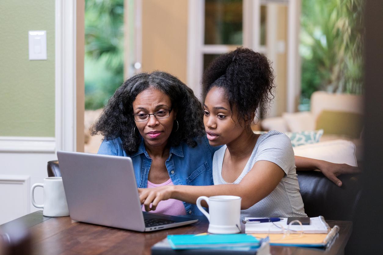 woman helping child refinance student loans