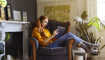 Millennial reading in living room