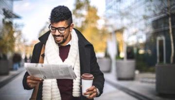 man reading student loan news