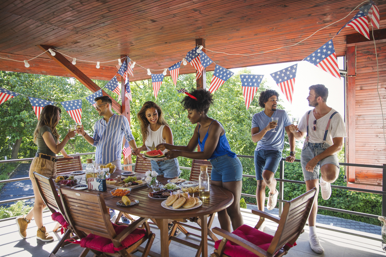 Friends celebrating 4th of July with barbecue