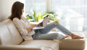 woman reading new about student loans