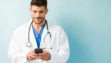 Doctor researching how to pay off medical school debt