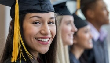 Woman smiling at college graduation
