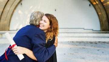 Dad with Parent PLUS loans hugging daughter
