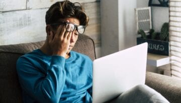 Man feeling overwhelmed by student loans