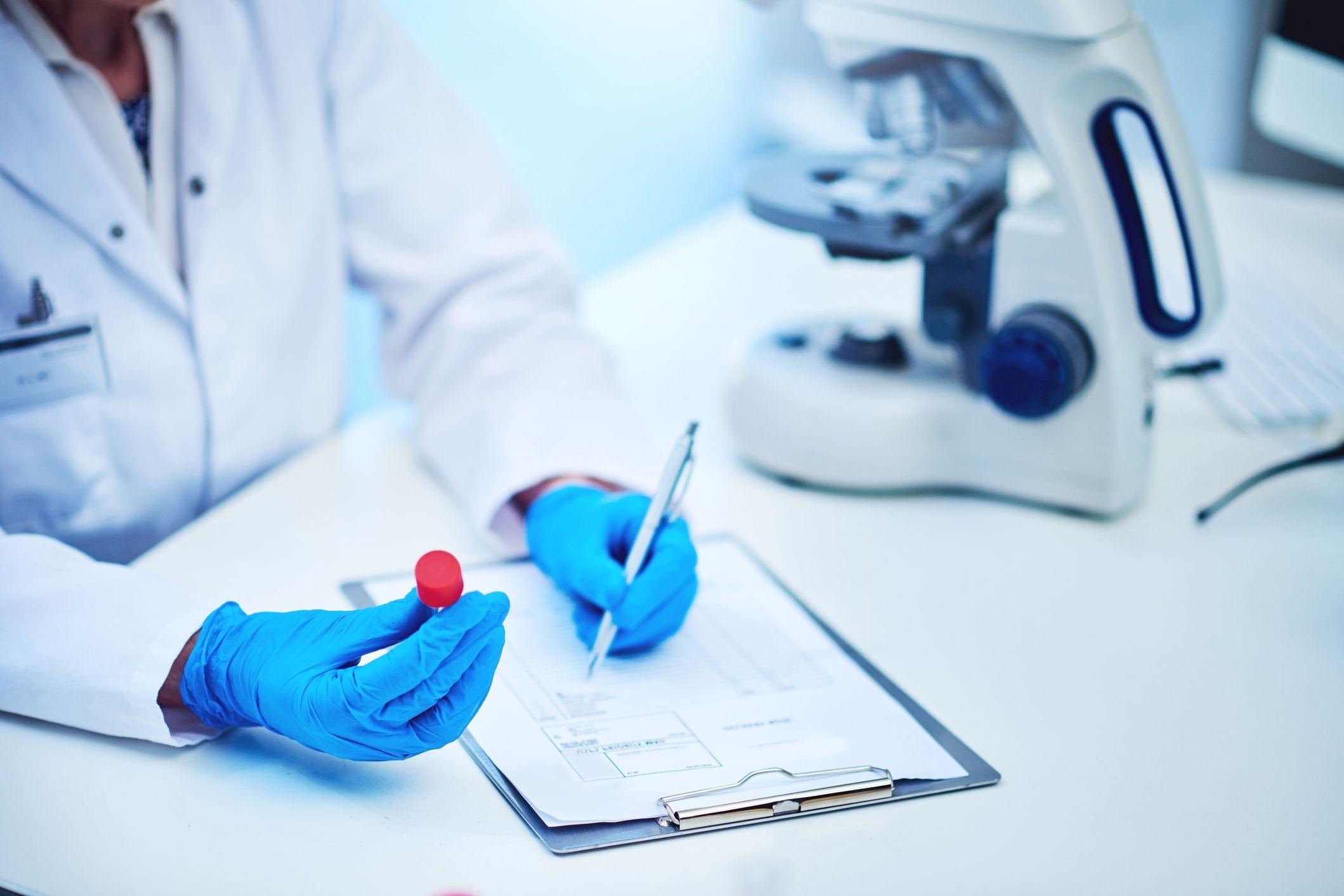 Medical professional holding test tube
