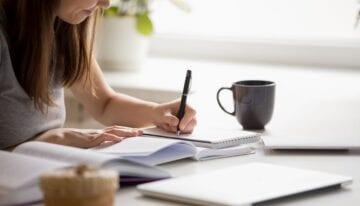 Girl writing a scholarship essay