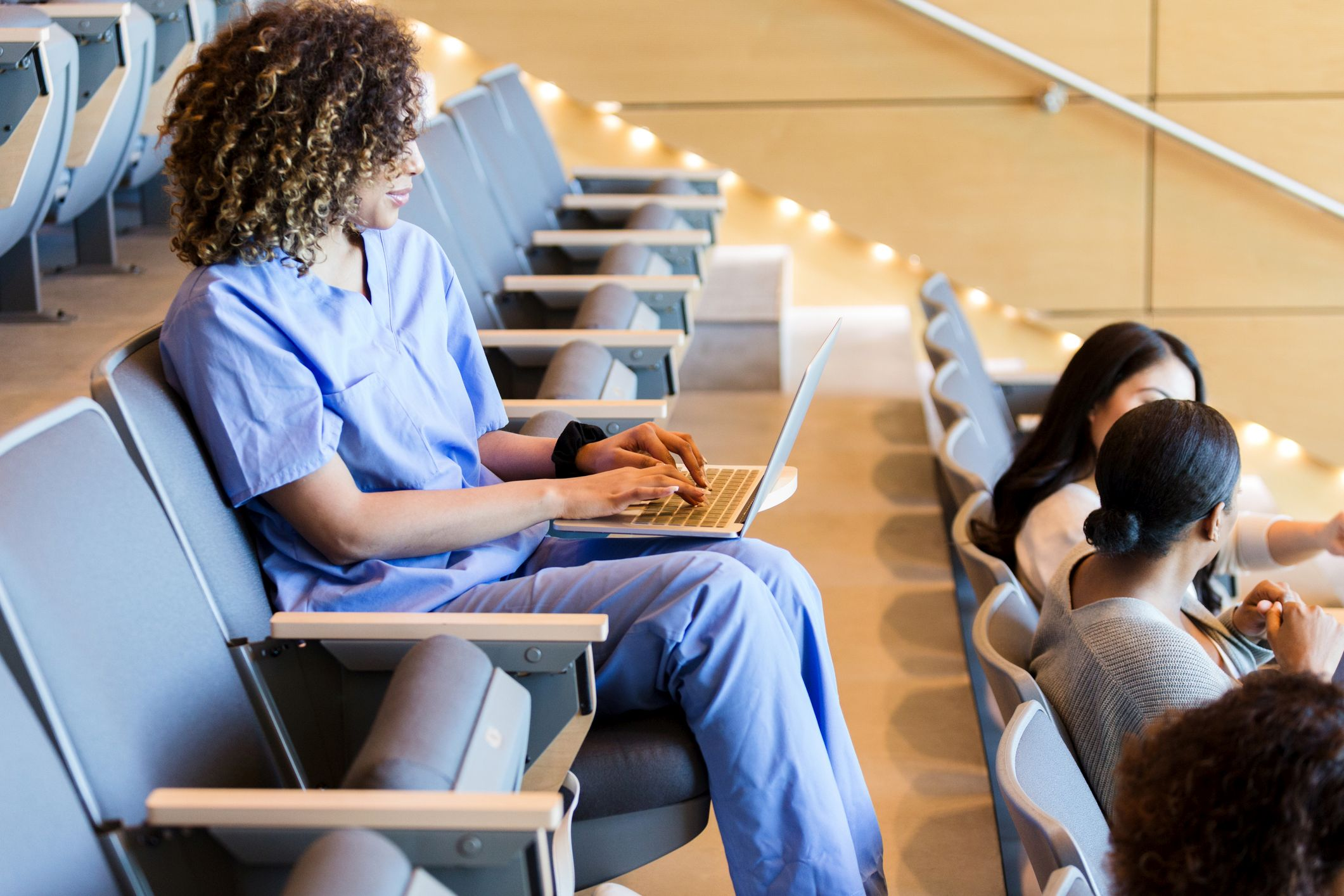 Woman taking notes in medical school