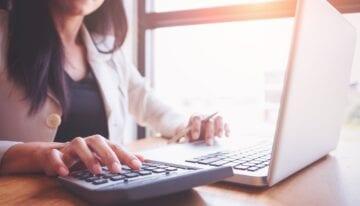 Woman calculating a principal payment vs. a regular payment