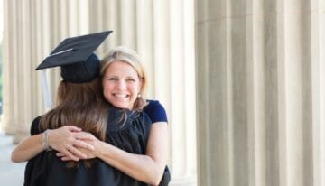 Parent with PLUS Loans hugging her graduate