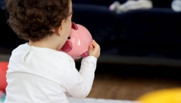 baby girl with piggy bank