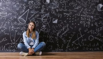 young female student in front of blackboard