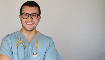 Young male nurse with glasses