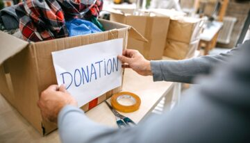 Man putting donation label on box