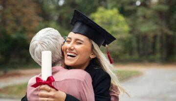 Woman with Parent PLUS Loans hugging graduate daughter