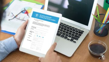 man filling Scholarship application form on internet