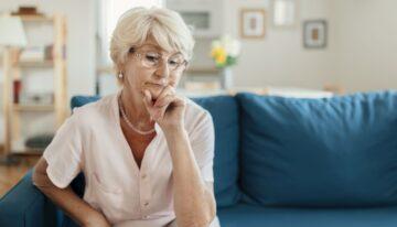 Senior citizen woman contemplating