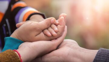 Father's mother's and baby's hand